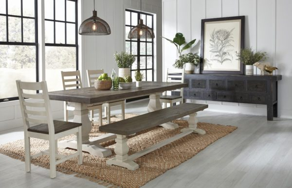 long black carved wood console in dining room setting