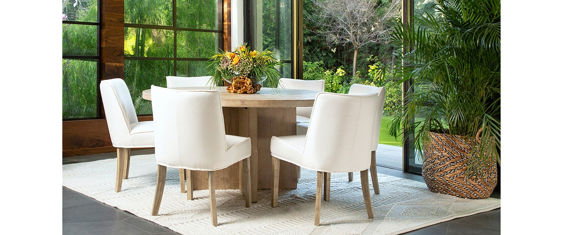Dining set of round table and 5 upholstered white chairs