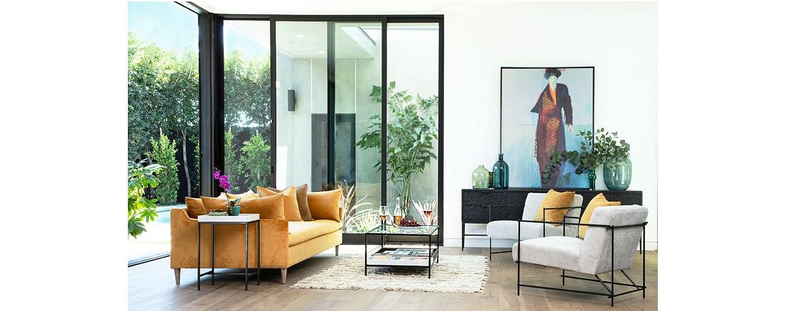 Living room with tall windows, brown sofa and Geisha painting