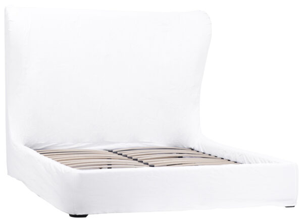 White slipcover bed with tall headboard
