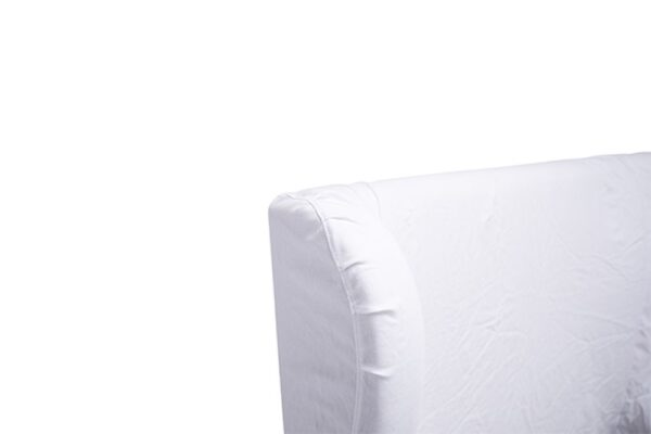 White slipcover bed with tall headboard corner detail