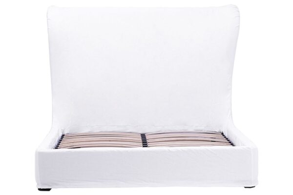 White slipcover bed with tall headboard front view