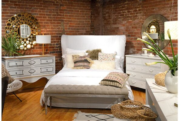 White slipcover bed with tall headboard shown in bedroom setting