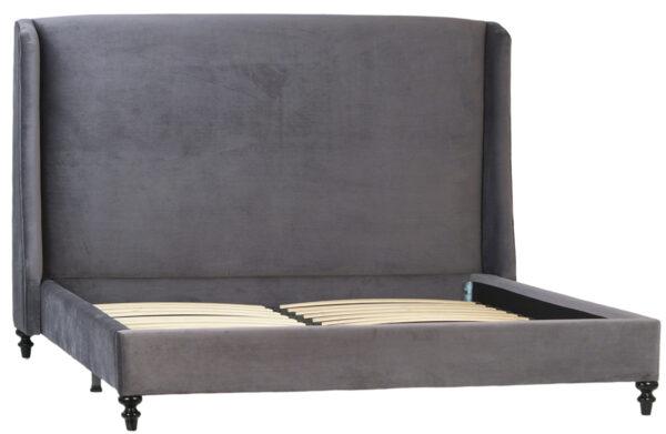 dark grey upholstered velvet bed with tall headboard