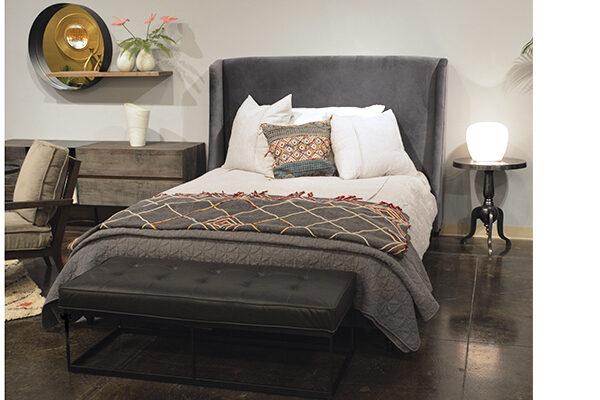 dark grey velvet bed in bedroom setting