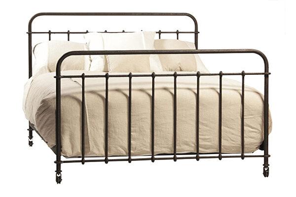 dark iron bed with bedding
