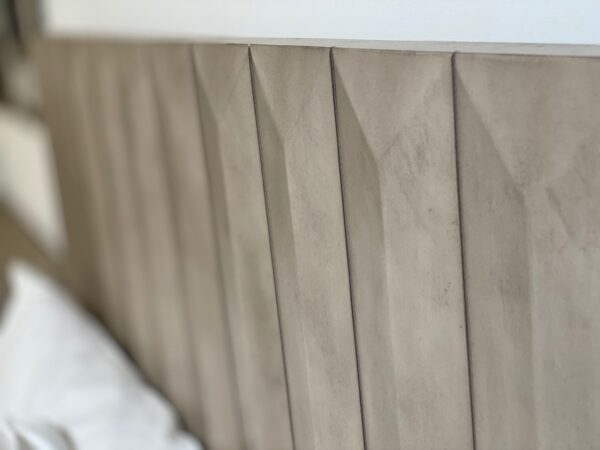wood bed close up of headboard