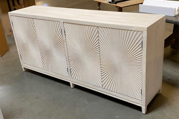 Light grey wash sideboard media console cabinet with carved doors seen from the side