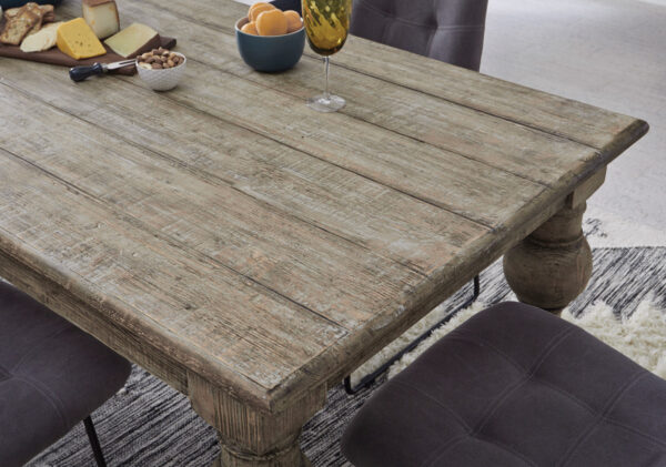 distressed wood dining table close up