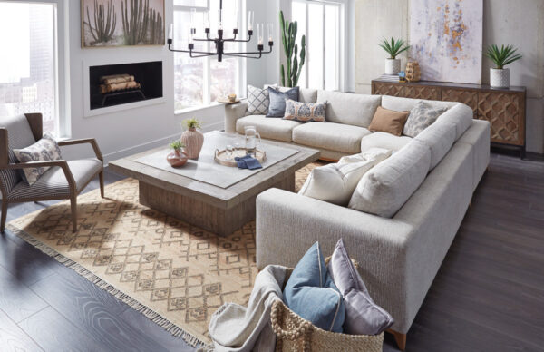Square wood coffee table in living room setting