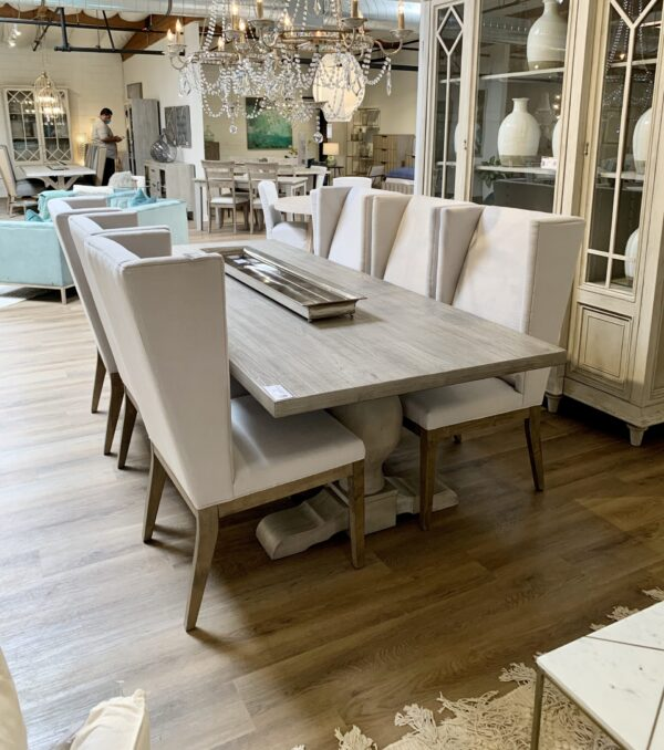 Long grey wash trestle dining table in dining room setting