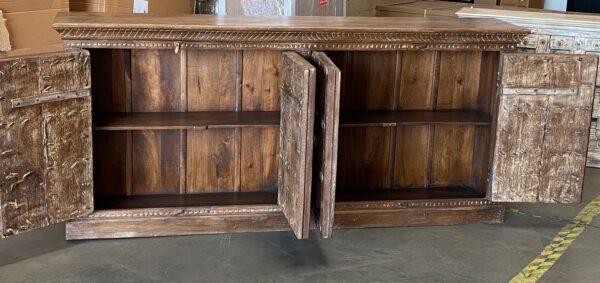 Large teak sideboard cabinet with 4 vintage Indian doors in medium brown finish seen with open doors