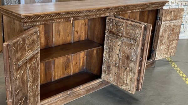 Large teak sideboard cabinet with 4 vintage Indian doors in medium brown finish view of interior