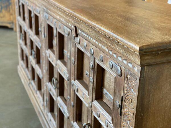 Large teak sideboard cabinet with 4 vintage Indian doors in medium brown finish front detail
