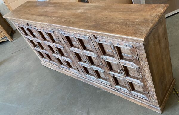 Large teak sideboard cabinet with 4 vintage Indian doors in medium brown finish view of the top