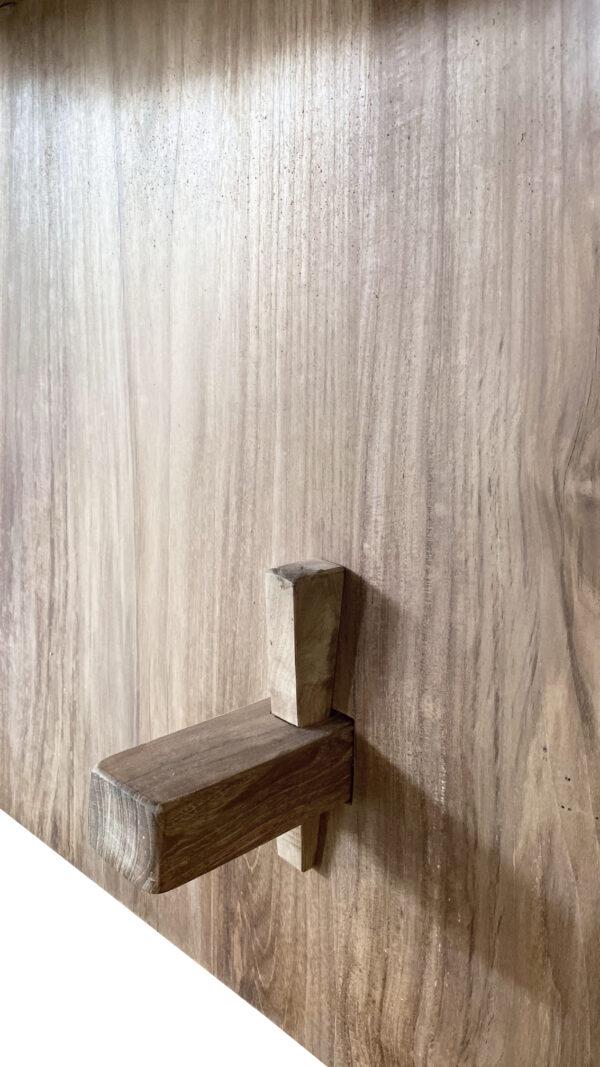 natural wood tone live edge dining table base close up