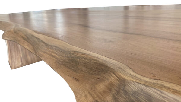 natural wood tone live edge dining table edge view