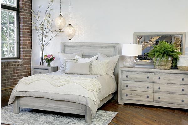 white wash wood dresser in bedroom setting