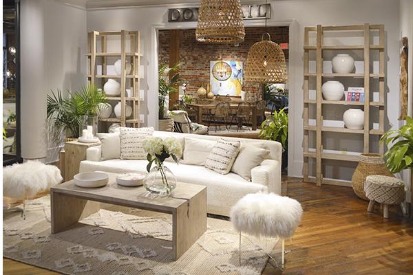 tall light wood bookshelf in living room setting