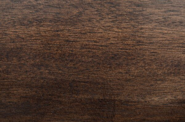 Dark walnut home office desk with black iron base and 2 drawers close up of top