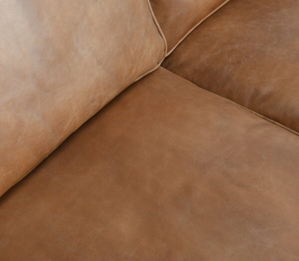 Caramel brown top grain leather sofa with 3 seats closeup of cushion